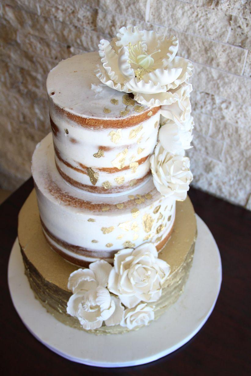 Semi-naked wedding cake with gold leaf